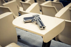 Armed campus. A gun in a lecture room / Armed campus concept royalty free stock photos