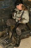 Armed combat female soldier. In ammunition with a mug in his hands Stock Photos