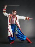 Armed cossack posing Royalty Free Stock Image