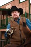 Armed Cowboy on Horseback. Tough old west cowboy on horseback with shotgun Royalty Free Stock Photography