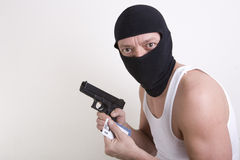 Armed credit thief Stock Images
