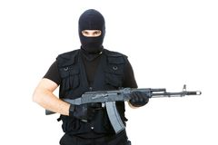 Armed criminal. Portrait of violent killer holding firearm and looking at camera with balaclava on his head Royalty Free Stock Photos