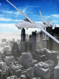 Armed drone. Armed surveillance UAV drone flying over a city stock photo