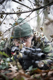 Armed forces. Special forces patrol in woods Stock Photography