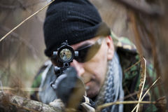 Armed forces. Special forces patrol in woods Royalty Free Stock Image