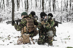 Armed forces. Special forces in winter patrol royalty free stock photo