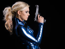 Armed girl. Martial young lady with gun royalty free stock photos