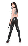 The armed girl. In clothes from latex royalty free stock photo