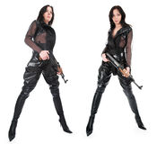 The armed girl. In clothes from latex stock photography