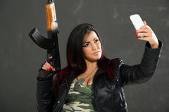 Armed Girl Taking Selfie Stock Image