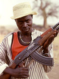 Armed guerrilla. Sudan , Nuba Mountains. A fighter of the Sudanese Nuba tribe with his Kalashnikov. Since 1991, the Nuba fought alone without supplies, depending Royalty Free Stock Photography
