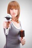 Armed hairdresser Stock Image