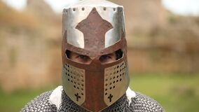 Armed knight with in helmet. Looking in camera stock video