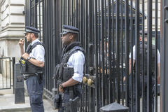 Armed london police. Downing street security armed police guarding gates Royalty Free Stock Image