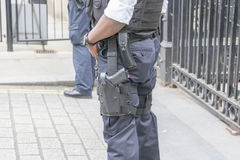 Armed london police weapon. Downing street security armed police guarding gates showing firearm Royalty Free Stock Image