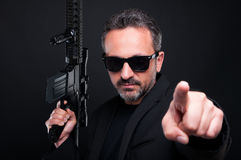 Armed mafia boss pointing you with finger. Getting ready to shoot Royalty Free Stock Photo