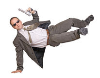 Armed man. In a suit jumping Royalty Free Stock Photos