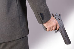 Armed man. With gun in hand royalty free stock photography