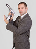 Armed man. Man with gun isolated on background Stock Image