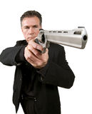 Armed man. Man aiming a 44 magnum handgun Stock Image