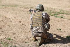 Armed man in camouflage with rifle in hands Stock Photos