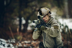 Armed  man in camouflage with sniper gun. In hands Royalty Free Stock Photos