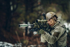 Armed  man in camouflage with sniper gun Royalty Free Stock Photo