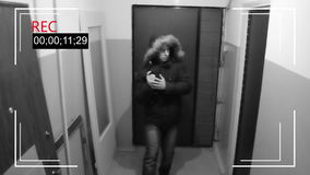An armed man snuck into the house for robbery stock video