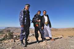 Armed men. Unidentified armed men dressed in camouflage uniform and ethnic attire with machine gun in Yemen on March 14, 2010. Three men are waiting a transport stock photos