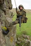 Armed military alpinist hanging on rope Royalty Free Stock Photo