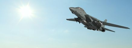 Armed military fighter jet in flight. In the sky Royalty Free Stock Image
