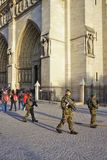Armed military soldiers with guns patrolling in front of the Notre Dame catholic cathedral in Paris stock images