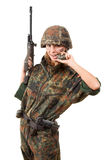 Armed military woman Stock Image