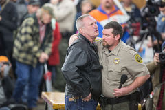 Oregon Armed Militia Standoff - Malheur Wildlife Refuge. Harney County Sherif, David Ward, hugs a community member at a packed town hall meeting concerning the Stock Image