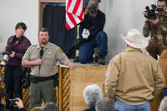 Oregon Armed Militia Standoff - Malheur Wildlife Refuge. Harney County Sherif, David Ward, listens to community members at a packed town hall meeting concerning Stock Image