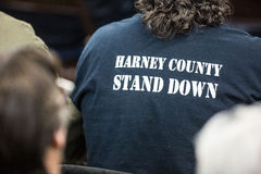 Oregon Armed Militia Standoff - Malheur Wildlife Refuge. A Harney County Stand Down shirt at a packed town hall meeting concerning the armed occupation of the Stock Image