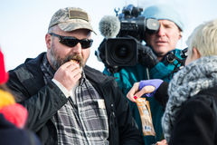 Oregon Armed Militia Standoff - Malheur Wildlife Refuge. An standoff supporter tries some vegan jerkey, given to him by PETA supporters outside the Malheur Royalty Free Stock Images