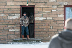 Oregon Armed Militia Standoff - Malheur Wildlife Refuge. A standoff supporter watches the main door, leading to the living quarters in the compound at the Stock Photography