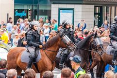 Armed mounted police forces riding at the end of Pride parade on Gedimino street. Event celebrating lesbian, gay, bisexual,. Vilnius, Lithuania - July 27, 2013 stock photo