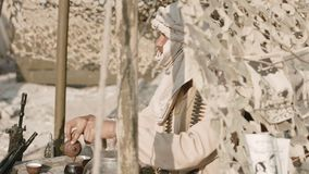 Armed mujahid pours tea stock video footage