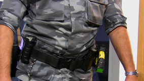 Armed officer with two guns