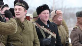 Armed people military uniform of  Soviet Army. St. Petersburg, Russia, November 21, 2016 Group of armed people military uniform of  Soviet Army, Historical stock video