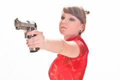 Armed with a pistol girl Stock Photography