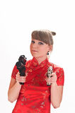 Armed with a pistol girl Royalty Free Stock Photography