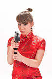 Armed with a pistol girl Stock Image