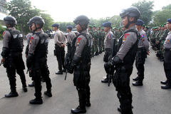 Armed police. Followed the briefing for the preparation of security in the city of Solo, Central Java, Indonesia stock photography