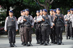 Armed police. Followed the briefing for the preparation of security in the city of Solo, Central Java, Indonesia stock images