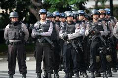 Armed police. Followed the briefing for the preparation of security in the city of Solo, Central Java, Indonesia stock image