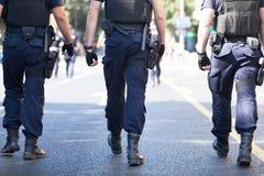 Armed police patrol stock photos