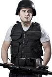 Armed police in protective cask with a gun Stock Photo